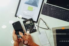 Top view of businessman hand working with finances about cost an Stock Images
