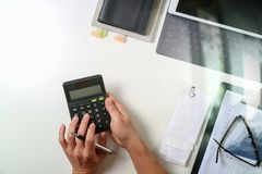 Top view of businessman hand working with finances about cost an Stock Image
