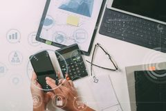 Top view of businessman hand working with finances about cost an Royalty Free Stock Photo