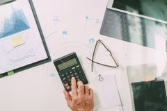 Top view of businessman hand working with finances about cost an Stock Photography