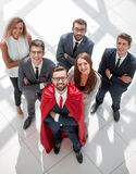 Top view.businessman superhero and his young business team stock photo