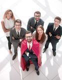 Top view.businessman superhero and his young business team royalty free stock photos