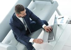 Top view businessman working on laptop with financial graphs Royalty Free Stock Photos