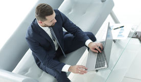 Top view businessman working on laptop with financial graphs Stock Images