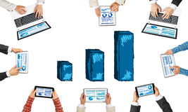 Top view of businesspeople sitting at table and using gadgets Stock Photo