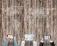 Top view of businesspeople sitting at table and using gadgets. Group of people with devices in hands working together as symbol of networking and communication Royalty Free Stock Photos