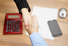 Top view of businesswoman shaking  hand  with businessman  after Stock Photo