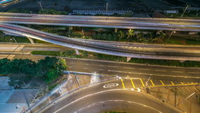 Top view of busy traffic night in finance urban timelapse, hong kong city. Top view of Kowloon busy traffic night on the road with overpass timelapse, hong kong stock footage