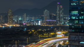 Top view of busy traffic night in finance urban timelapse, hong kong city. Top view of Kowloon busy traffic night on the road with towers in finance urban stock footage