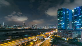 Top view of busy traffic night in finance urban timelapse, hong kong city. Top view of Kowloon busy traffic night on the road with towers in finance urban stock video footage