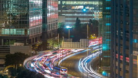 Top view of busy traffic night in finance urban timelapse, hong kong city. Top view of busy traffic night on the road between towers in finance urban timelapse stock video footage