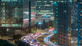 Top view of busy traffic night in finance urban timelapse, hong kong city. Top view of busy traffic night on the road between towers in finance urban timelapse stock video