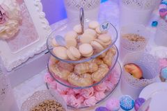 Three tiered glass cake stand with delicious French confectionery. Top view of cake stand at a dessert bar for a wedding, party or event, exhibiting different Royalty Free Stock Photography