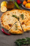 Top view of calzone pizza or chicken mushroom pie. With pepper, lemon, rosemary and tea Royalty Free Stock Photo