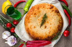 Top view of calzone pizza or chicken mushroom pie. With vegetables Royalty Free Stock Image