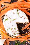 Top view on camembert cheese with carrot around Stock Photos