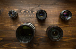 Top view of camera lenses organized in shape of Olympic emblem Stock Photography
