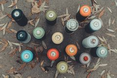 Top view of cans with colorful spray paint. For graffiti stock images