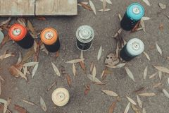 Top view of cans with colorful spray paint. For graffiti royalty free stock image