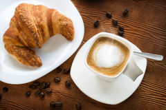 Top view of cappuccino coffee with croissant. Stock Images