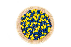 Top view Capsule in basket the white background Stock Images