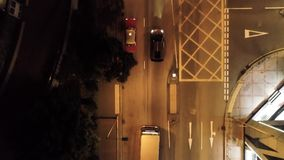 Top view on car in the Hong Kong at night. Stock. Lamborghini is driving in the city on the night road.  stock video