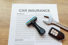 Top view of car insurance with car remote key, wrench and rubber Royalty Free Stock Photos