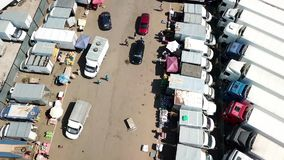 Top view of the car market. shooting with copter. Kazan, Russia - 08.04.2018: The largest food market in the city of Kazan. Here are sold fruits and vegetables stock video