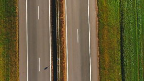 Top view car slowly driving along highway. Cars driving on suburban road stock footage