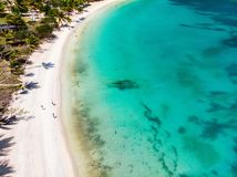 Top view of Caribbean island. Aerial drone view of tropical island of Mayreau, turquoise Caribbean sea and a family with kids in St Vincent and Grenadines stock photo