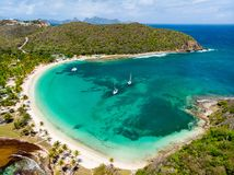 Top view of Caribbean island. Aerial drone view of tropical island of Mayreau and turquoise Caribbean sea in St Vincent and Grenadines royalty free stock images