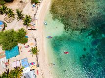Top view of Caribbean island. Aerial drone view of tropical island of Mayreau and turquoise Caribbean sea in St Vincent and Grenadines royalty free stock photos