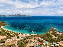 Top view of Caribbean island. Aerial drone view of tropical island of Mayreau and turquoise Caribbean sea in St Vincent and Grenadines stock images