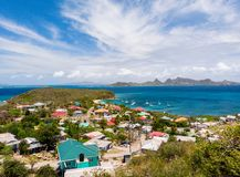 Top view of Caribbean island. Aerial drone view of tropical island of Mayreau and turquoise Caribbean sea in St Vincent and Grenadines royalty free stock image