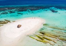 Top view of Caribbean island. Aerial drone view of tiny tropical Mopion island sandbar, turquoise Caribbean sea and a family with kids in St Vincent and stock photo