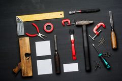 Top view of carpenter tools equipment set on wooden table Royalty Free Stock Image