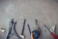 Top view, Carpenter work area with many tools on Dusty concrete floor, Craftsman tools set Stock Photo