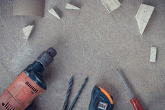 Top view, Carpenter work area with many tools and scantling on Dusty concrete floor, Craftsman tools set Royalty Free Stock Image