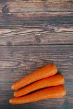 Top view of carrot on wooden background. Copy space for text or logo. Vertical shot. Food orange raw ingredient closeup object fresh healthy organic delicious stock photo