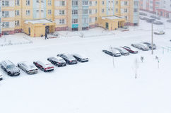 Top view of cars in courtyard at time of heavy blizzard Royalty Free Stock Photo