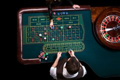 Top view of the casino croupier and the green roulette table. Ga. Gambling table in luxury casino. Top view of the casino croupier and the green roulette table stock photography