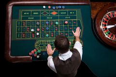 Top view of the casino croupier and the green roulette table. Ga. Gambling table in luxury casino. Top view of the casino croupier and the green roulette table stock photos