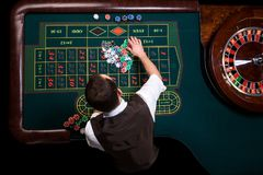 Top view of the casino croupier and the green roulette table. Ga. Gambling table in luxury casino. Top view of the casino croupier and the green roulette table stock photo