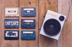 Top view Cassette tape and speaker laying on wood. Board stock photography
