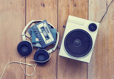 Top view Cassette tape and speaker laying on wood floor stock photos
