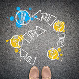 Top view of casual man's shoes and a flowchart with arrows. Royalty Free Stock Photo