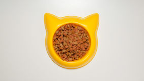 TOP VIEW: Cat meal on a yellow pet dish Royalty Free Stock Photos