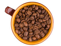 Top view of ceramic cup with coffee beans Stock Image