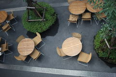 Top view of chairs in outdoor cafe. Many chairs and tables on road in front of a cafe Royalty Free Stock Images
