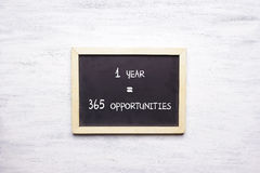 Top view of chalkboard with 1 YEAR, 365 OPPORTUNITIEs Royalty Free Stock Image
